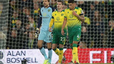 The Norwich players look dejected after conceding their third goal in the Premier League game agains