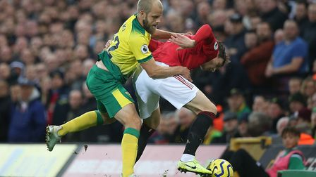 Teemu Pukki and Victor Lindelof battle during Sunday's encounter between Norwich City and Manchester