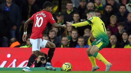 Emiliano Buendia and Marcus Rashford in action during the Premier League match at Carrow Road. Pictu