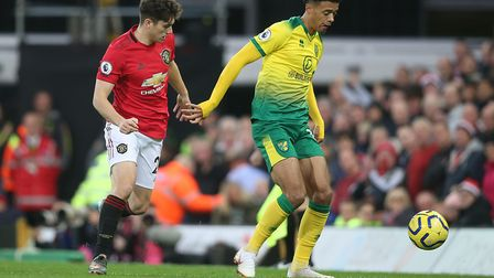 Daniel James and Jamal Lewis in action during the Premier League match at Carrow Road Picture: Paul
