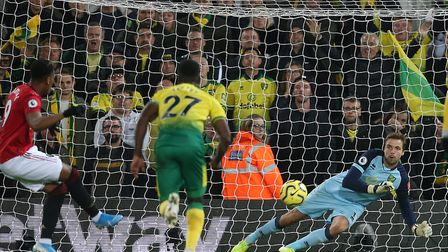 Tim Krul makes his second penalty save of the first half in Norwich City's 3-1 Premier League defeat