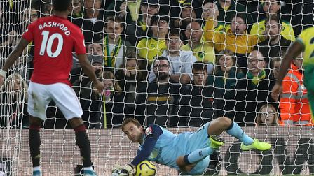 Norwich City keeper Tim Krul denies Marcus Rashford from the penalty spot in the first half Picture: