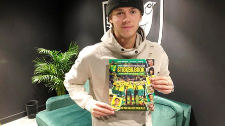 Norwich City midfielder Todd Cantwell with his signed sticker for the PinkUn Podcast competition Pic