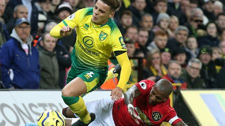 Norwich City full back Max Aarons is hacked down by Manchester United captain Ashley Young Picture: