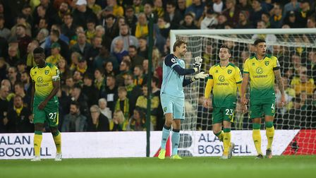 Norwich players look dejected after conceding the first goal against Manchester United Picture: Paul