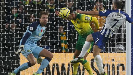 Tim Krul watches closely as Norwich City defender Ben Godfrey thwarts Brighton striker Neal Maupay w
