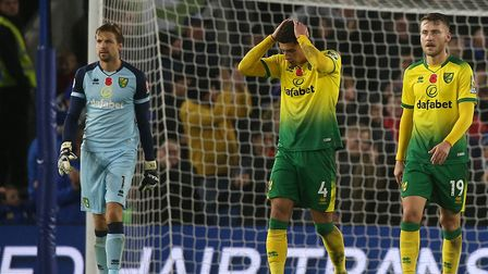 The disappointment was obvious for Canaries players, from left, Tim Krul, Ben Godfrey and Tom Trybul
