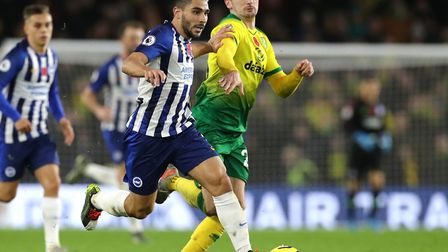 Canaries midfielder Kenny McLean battles with Brighton striker Neal Maupay during Saturday's loss on