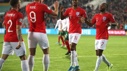 England's Raheem Sterling (right) celebrates scoring his side's fourth goal of the game during the U