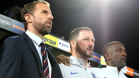 England manager Gareth Southgate, assistant manager Steve Holland and coach Chris Powell used UEFA's