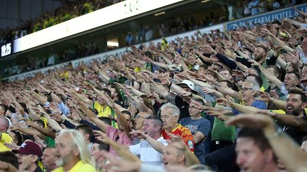 The Barclay stand has become a sea of vibrant colour and noise, with Daniel Farke's celebration beco