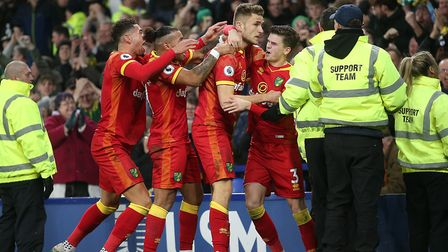City players celebrate with the travelling contingent after Dennis Srbeny's second goal. Picture: Pa