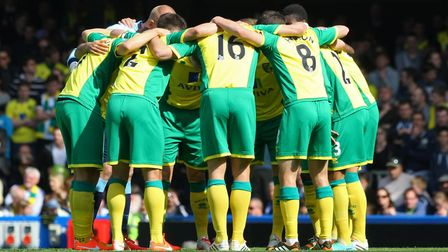 Norwich players in a pre-match huddle before the game at Chelsea at the end of the 2013-14 season -