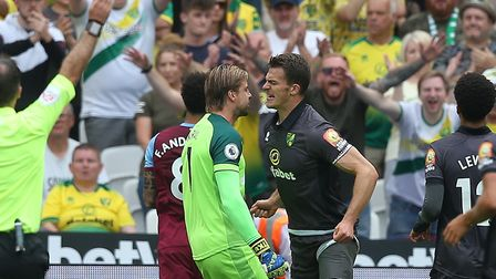 Norwich City fans celebrate a heropic block from captain Christoph Zimmermann during his brief Premi