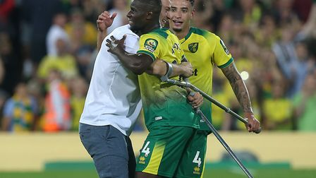Christoph Zimmermann couldn't resist running on to the Carrow Road pitch to congratulate his Norwich