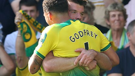 Grant Hanley celebrates with Ben Godfrey following Norwich City's 3-1 home win over Newcastle in Aug