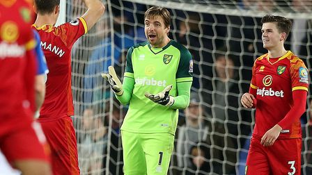 Tim Krul and Christoph Zimmermann celebrate keeping a clean sheet during Norwich City's 2-0 win at E