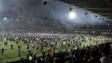 Finnish fans join players to celebrate their victory in the Euro 2020 Group J qualifying soccer matc