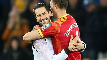 Mario Vrancic gets a hug from Christoph Zimmermann after Norwich City's 2-0 Premier League win at Ev