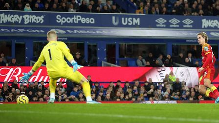 Norwich City attacker Todd Cantwell slots Everton keeper Jordan Pickford Picture: Paul Chesterton/F