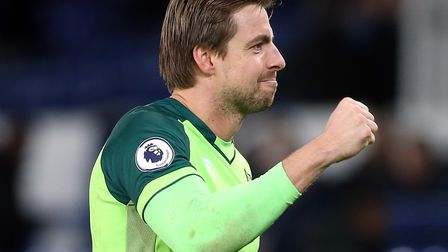 Tim Krul celebrates victory with the traveling Norwich fans at Everton Picture: Paul Chesterton/Focu