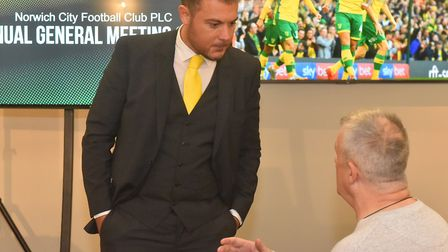 Chief operating officer Ben Kensell speaks to a shareholder at Norwich City's AGM. Pictures: BRITTAN