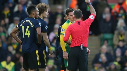 Kenny McLean is shown a yellow card for a poor challenge on Matteo Guendouzi. Picture: Paul Chestert