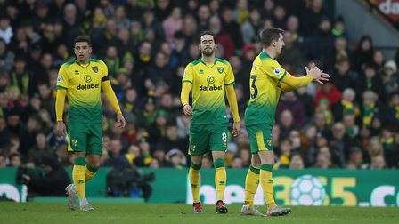 The Norwich players look dejected after conceding a second goal against Sheffield United Picture: Pa