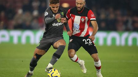 Max Aarons and Nathan Redmond battle for possession. Picture: Paul Chesterton/Focus Images