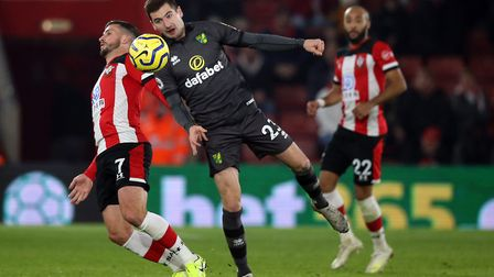 Shane Long and Kenny McLean in action during Norwich City's 2-1 defeat at St Mary's. Picture: Paul C