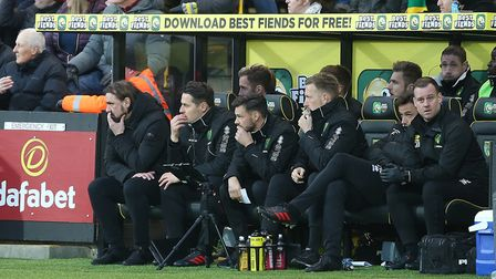 Daniel Farke and the Norwich City bench ponder what to do next after the Blades second goal. Picture