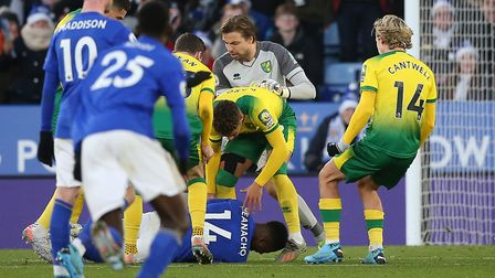 Tempers flare after Kelechi Iheanacho of Leicester City played on from a throw in after Norwich City