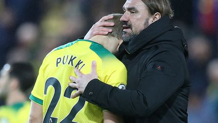 Norwich City hot shot Teemu Pukki gets a hug from Daniel Farke after a rare off day in front of goal