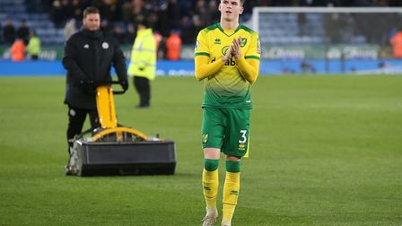 Sam Byram of Norwich applauds the traveling support at the end of the Premier League match at the Ki