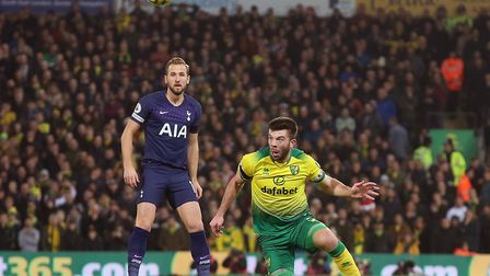 Grant Hanley beats Harry Kane to the ball during Norwich City's draw with Spurs Picture: Paul Cheste