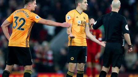 Wolverhampton Wanderers' Conor Coady (centre) and Leander Dendoncker appeal to Referee Anthony Taylo