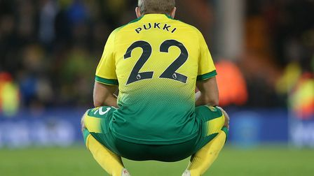 Teemu Pukki looks dejected as the final whistle confirms defeat for the Canaries. Picture: Paul Ches