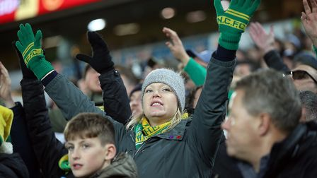 The home fans get behind their side during the Premier League match at Carrow Road, NorwichPicture b