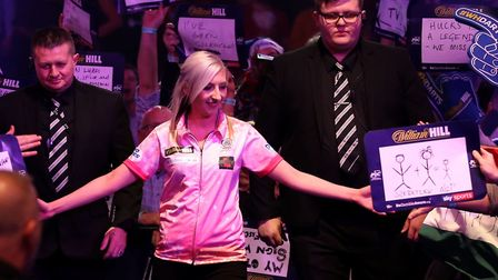 Fallon Sherrock begins her walk out ahead of the match against Ted Evetts, with a tribute to Darren