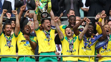 Russell Martin, lifting the play-off final trophy at Wembley, made the most appearances of any Norwi