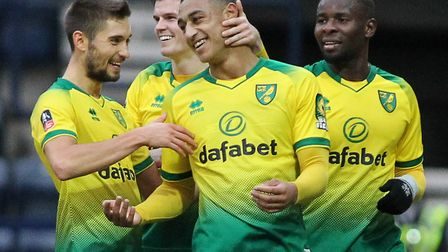 Adam Idah of Norwich City celebrates with his team mates after scoring the third goal against Presto