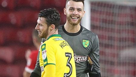 Angus Gunn and James Husband, front, savour Norwich City's win at Middlesbrough in September 2017 Pi