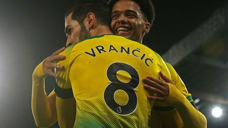 Jamal Lewis congratulates Canaries team-mate Mario Vrancic on his first Premier League goal Picture: