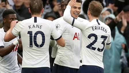 Dele Alli, second right, celebrates scoring Tottenham's winner against Brighton on Boxing Day Pictur