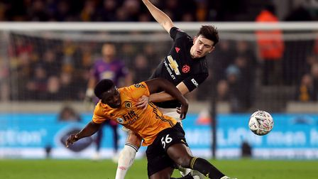 Manchester United's Harry Maguire (right) and Wolverhampton Wanderers' Benny Ashley-Seal battle for