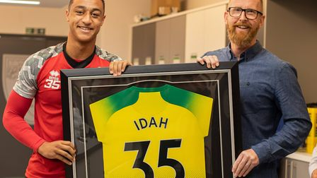 Iwan Roberts presents Adam Idah with a permanent reminder of his Norwich City debut Picture: Norwich