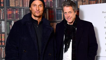 Hugh Grant, right, and Matthew McConaughey attending The Gentlemen photocall held at Empire Haymarke