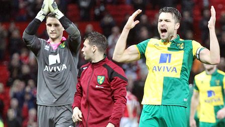 Declan Rudd celebrates Norwich City's 2015 victory with Wes Hoolahan and Russell Martin, right, at M