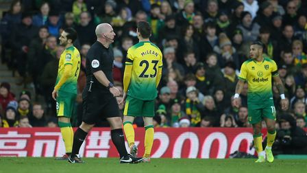 Norwich players look dejected after conceding their second goal against Sheffield United Picture: Pa