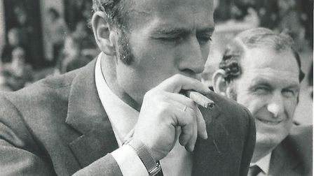 Ron Saunders, with coach Terry Allcock at his side, allows himself a celebration cigar after promoti